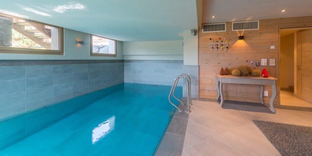 Luxury real estate in Switzerland Chalet Belvarde pool Verbier
